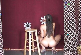 Slutty pet Aryana Starr gives head and rides a dick thru a gloryhole
