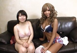 Japanese pornstars drop their clothes to pleasure each other