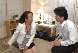 Japanese mature undresses for a big round of merciless sex