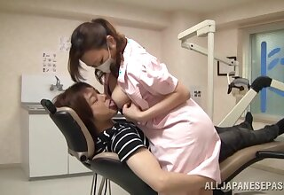 Horny Japanese nurse spreads her hooves to ride a lucky if it happens