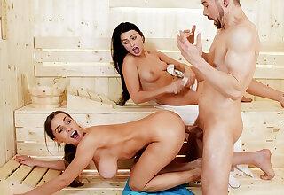 Buxomy woman in sauna taunts while wifey sleep