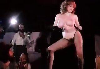 Busty redhead striptease
