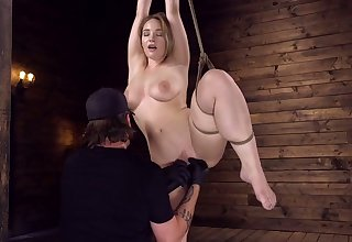 Booked up and suspended hottie Hadley Viscara squirts in the matter of the dark BDSM room