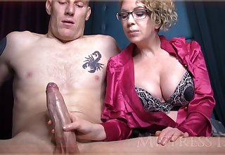 Flagitious mature girl with blondie hair and glasses is groping manhood down front of the camera