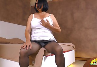 Old sprog flaunting her sexy pantyhose and playing with her titties