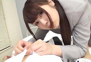 Nice tits Japanese secretary Kirishima Sakura gives a titjob